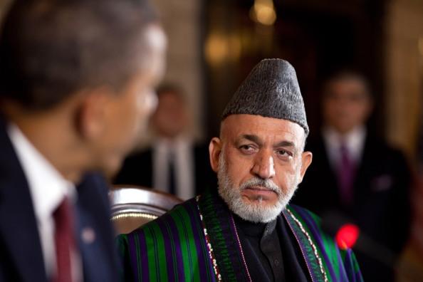 Hamid_Karzai_listens_to_Barack_Obama_in_Kabul_2012